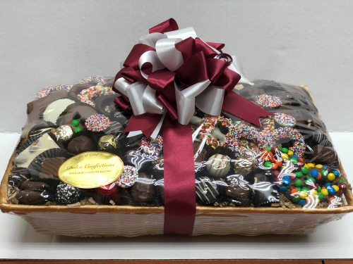 Assorted chocolate and pretzels in a basket.
