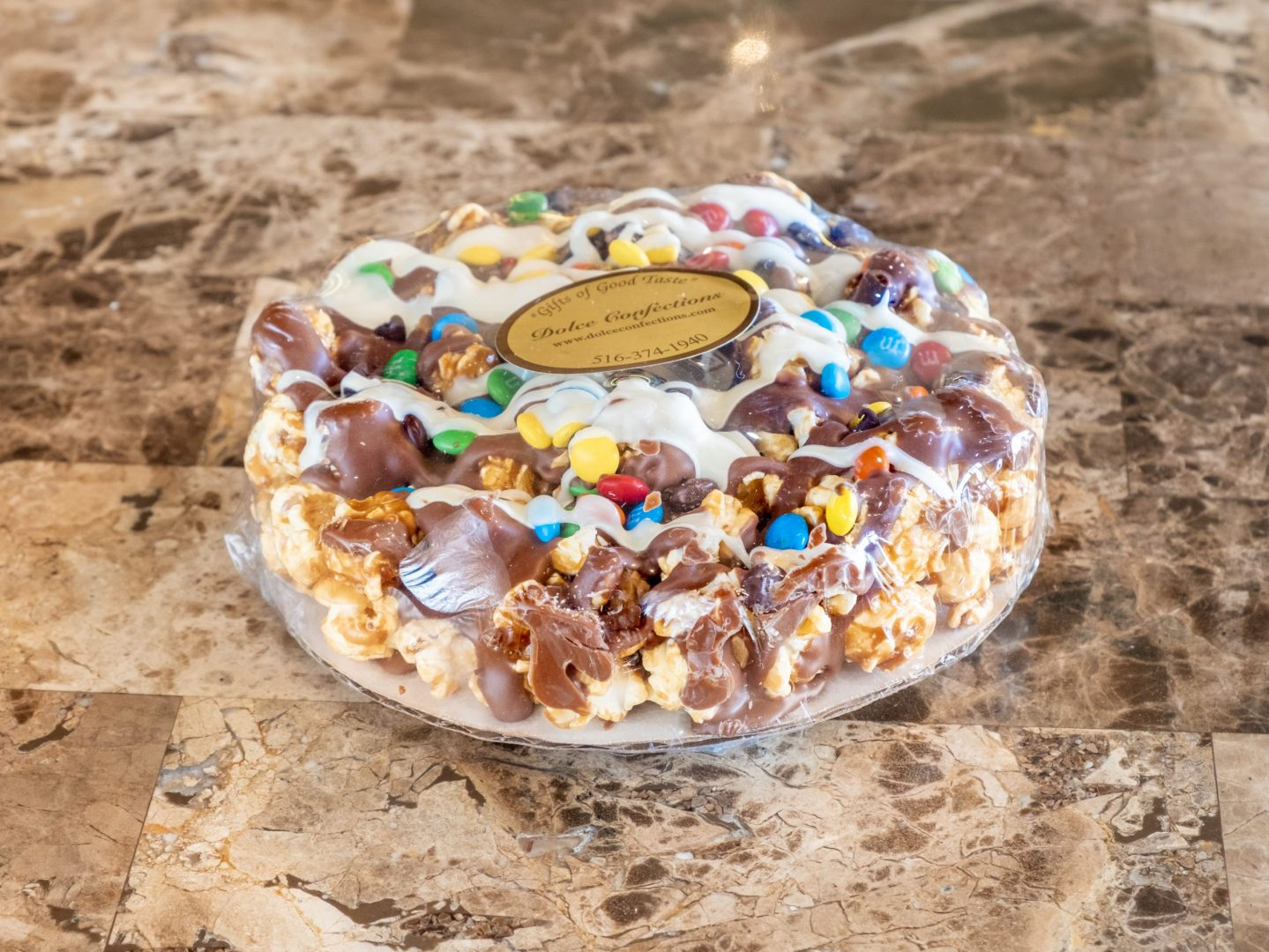extra small popcorn pizza drizzles with chocolate.