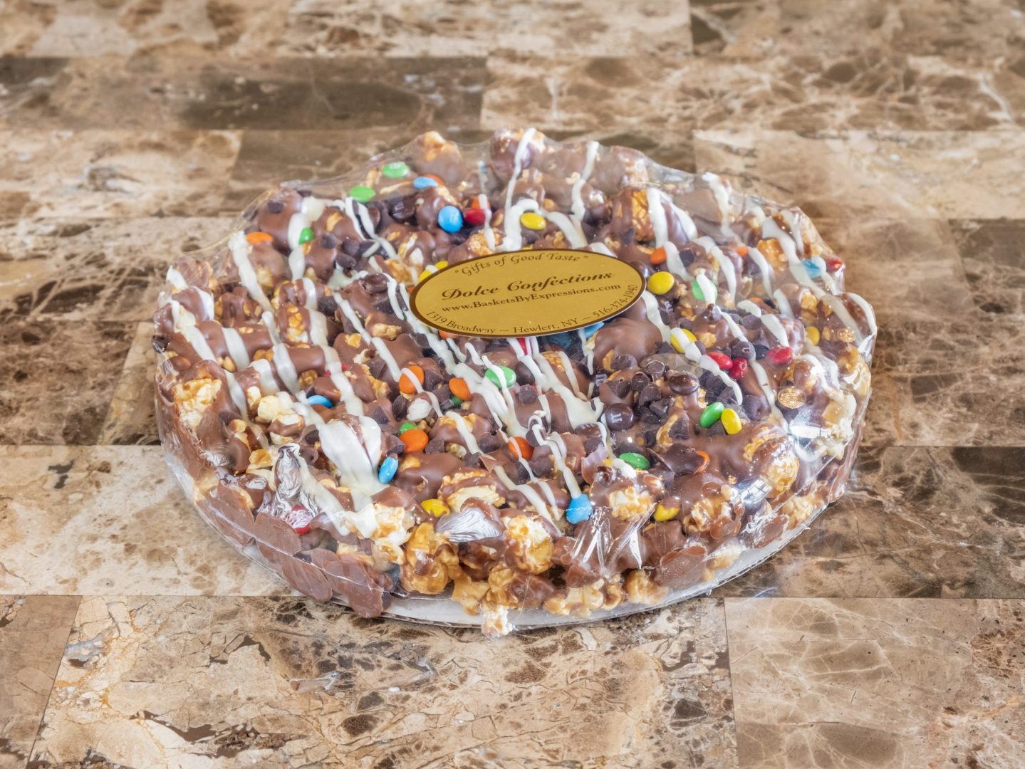 small popcorn pizza drizzled in chocolate.