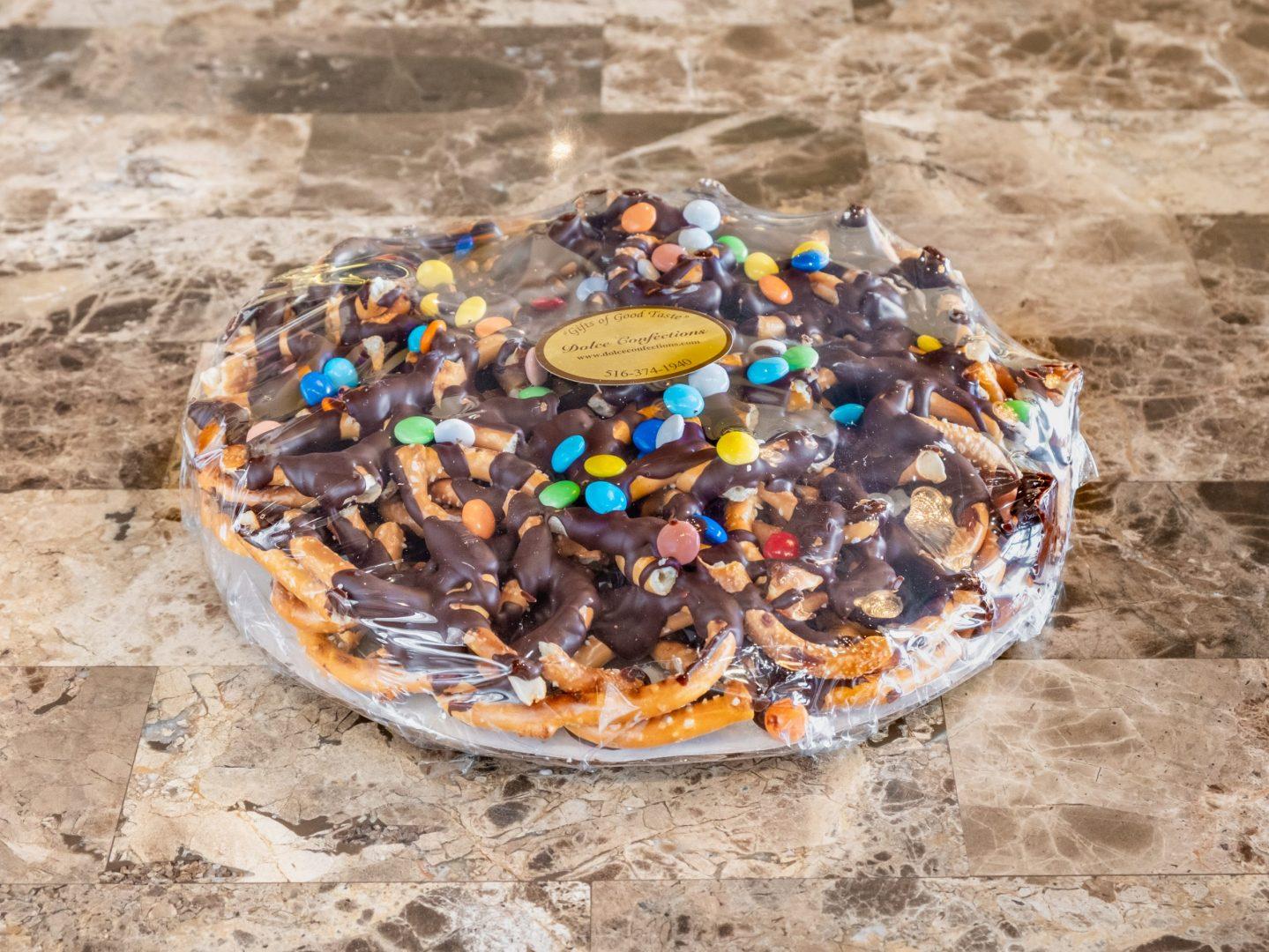 small pretzel pizza with chocolate drizzle.