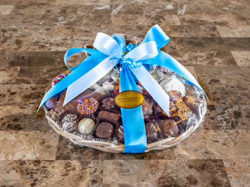 Assorted chocolates and chocolate covered pretzel pizza basket.