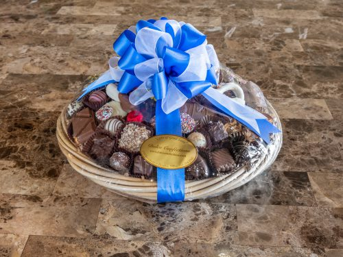 Assorted chocolates and chocolate covered pretzel basket.