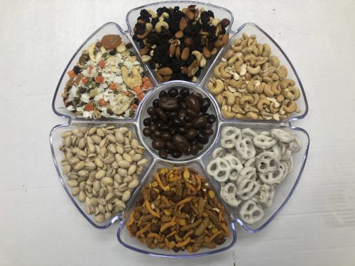 assorted nuts and dried fruits in a tray.