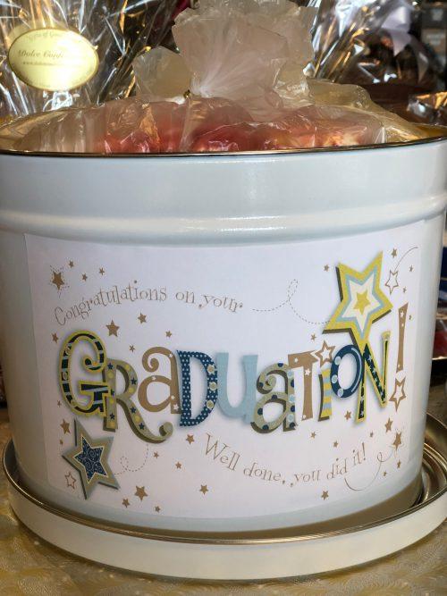 Graduation tin with assorted treats.