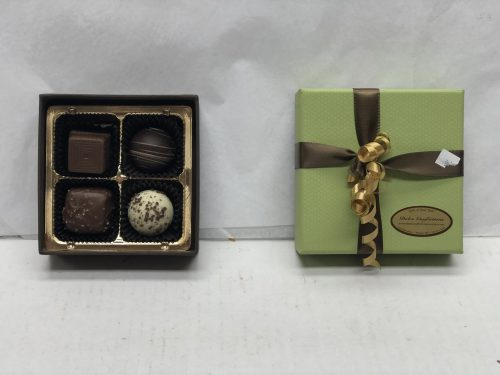 4 chocolate truffles in a box.